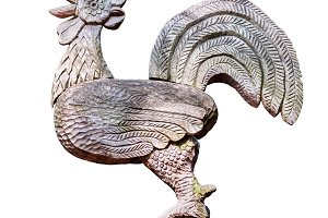 Rooster wood carving on white