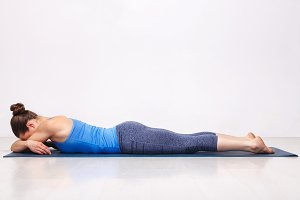 Womand relax in Hatha yoga asana Makarasana