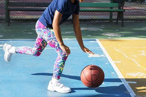 Black girl playing basketball