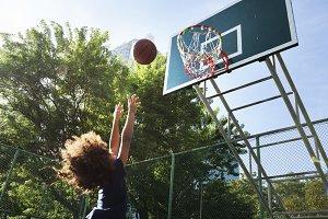 Black girl playing basketball