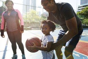 Black family playing basketball