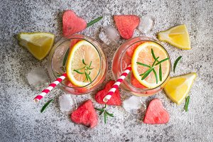 Watermelon lemon lemonade with pieces of watermelon in shape of heart. Refreshing summer drink concept
