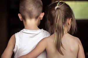 the little boy and girl hug