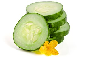 slices of cucumber with flower isolated on white background