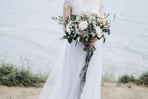 Gorgeous bride with wedding flowers