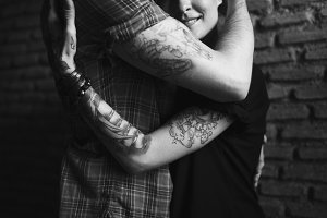 Hipster couple hugging
