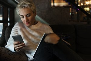 Caucasian woman using smart phone