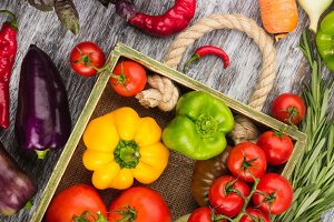 Set of raw vegetables in the wooden tray