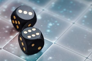 Black dice on the playing field. The concept of board games.