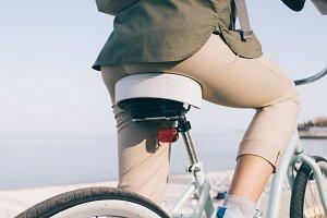 slender girl in beige pants