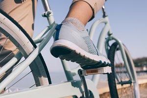 Female foot in a blue sneaker