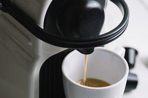 machine serving espresso coffee