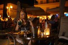 Woman enjoying a drink in a pub