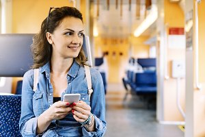 Beautiful woman using her mobile.