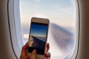 Taking photo on plane with mobile.