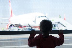 Little boy watching planes at the ai