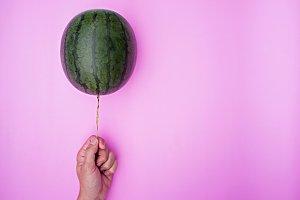 Hand holding Balloon watermelon