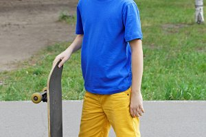 Handsome boy teenager with skateboard