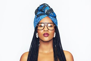 Sensual black woman wearing glasses and ethnic head wrap
