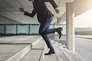 Running up fast man wearing suit