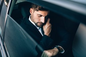 Businessman travelling by car