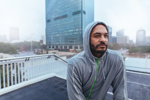 Portrait of a male runner in hooded