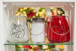 Three glass candle holders jars