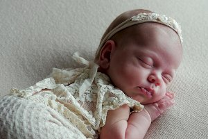 baby girl infant in dress asleep
