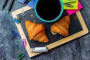 School business stationery croissants mug of coffee on grunge chalkboard