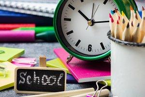 School stationery, supplies, pencil, pen, note on grunge chalkboard