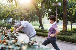 Senior couple exercising at park