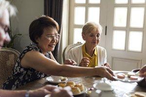 Senior friends dining together