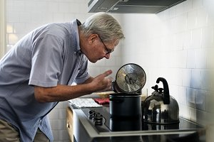 Caucasian senior man cooking