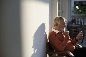 Senior man using phone