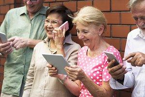 Senior group using digital devices