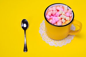 cup with multi-colored marshmallow