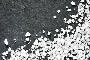 coarse sea salt on dark background close up