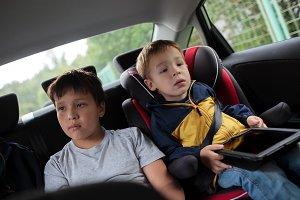 Children sitting in the car