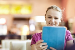 Young happy woman in cafe