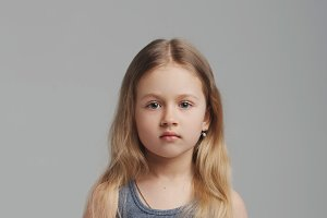 little girl studio portrait on grey background