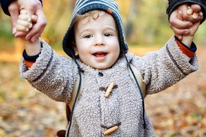 Cute laughing kid in warm clothes