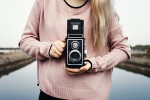 Girl using a vintage camera
