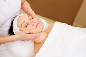 Woman taking facial treatments