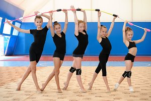 Young female gymnasts making bow