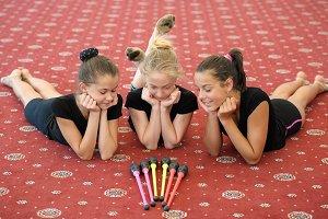 Three girls on the floor looking