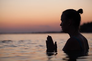 Woman in water during pray