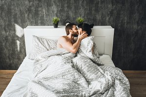 The couple is at home in bed