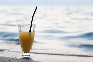 Glass of cocktail beach near water