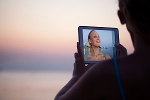 Woman making selfie on resort using