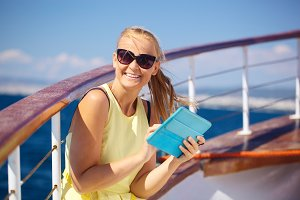 Happy woman with pad during sea